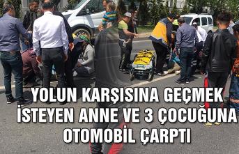 Yolun karşısına geçmek isteyen anne ve 3 çocuğuna otomobil çarptı...