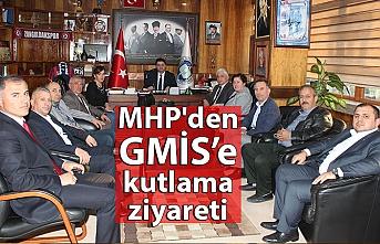 MHP'den GMİS'e kutlama ziyareti