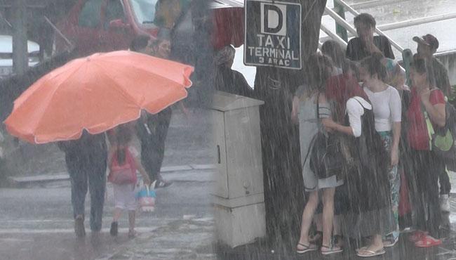 Yağmur bir anda bastırdı, vatandaşlar kaçacak yer aradı