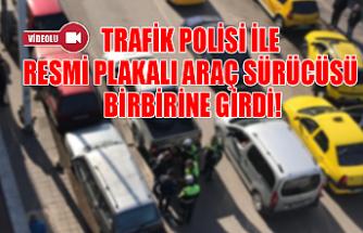 Trafik polisi ile resmi plakalı araç sürücüsü birbirine girdi!